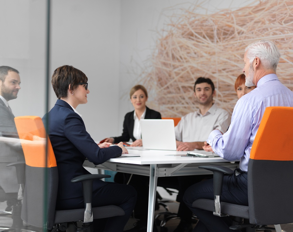 business people group on meeting at modern bright office indoors. Senior  businessman as leader in discussion..jpeg